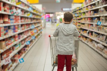 Child with shopping cart