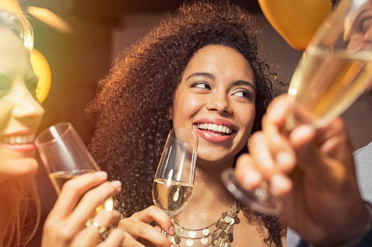 Happy woman drinking champagne at party