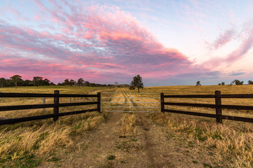 Country timber farm gate with colourful sky Wall mural