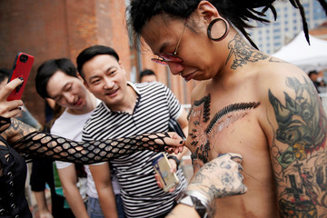 Angus Shen shows his body pierced by professional body artist Wei Yilaien during the Shanghai Tattoo Extreme and Body Art Expo 2017 in Shanghai