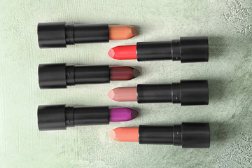 Lipsticks of different shades on light background