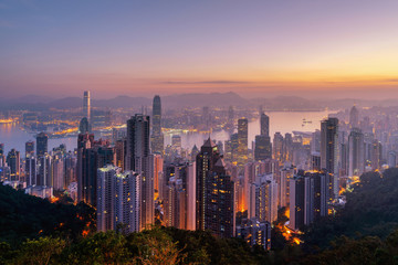 Aerial view of Hong Kong Downtown and Victoria Harbour. Financial district and business centers in smart city, technology concept. Skyscraper and high-rise buildings at sunrise.