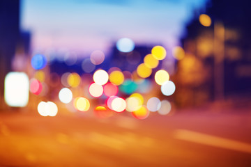 Trafficlights in the city at night time. Urban road view with beautiful bokeh