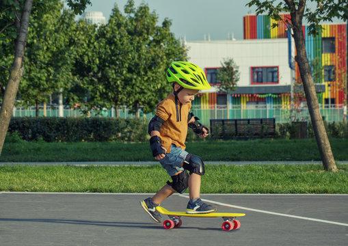 A little boy enjoys a yellow cruiser penny plastboard