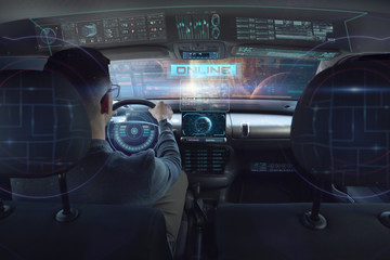 in a futuristic world a person drives a car of the future with holographic technology and augmented reality, concept of transportation and immersive technology linked to travel,  cars withAutopilot
