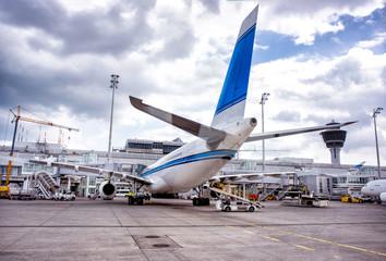 Loading of big aeroplane at airport. Wall mural