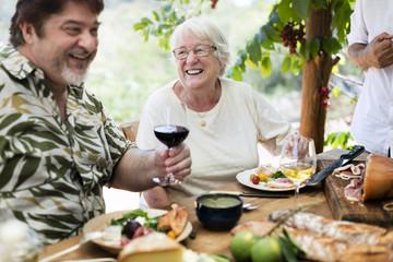 Family enjoying a Mediterranean dinner outdoors