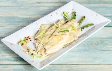 Plate of seabass fillet with grilled asparagus