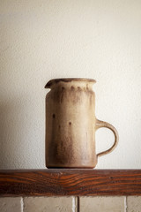 an italian pitcher of pottery
