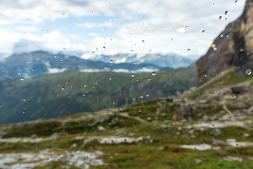 Idyllic view of Adamello Brenta National Park through a window with raindrops, South Tyrol / Italy