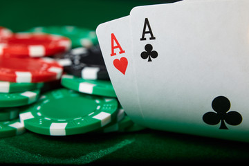 A pair of aces and chips on poker table. Winning hand.