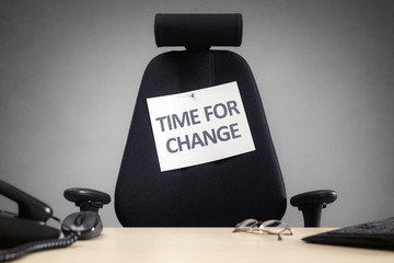 Time for change empty business chair with sign in office