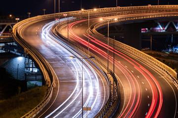 Road car light streaks. Night light painting stripes. Long exposure photography.