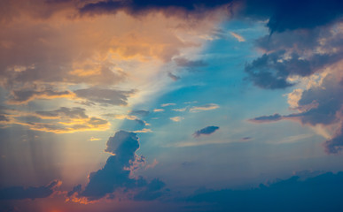 Beautiful and colorful cloudscape with sun rays