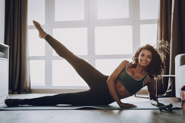 Afro American Young Girl. Home Fitness Concept.