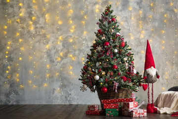 Christmas tree decorated by garlands and lights. Copy space