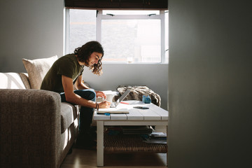 Side view of a student studying at home