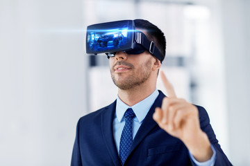 business, technology, augmented and virtual reality concept - businessman with some machine on display of vr headset at office