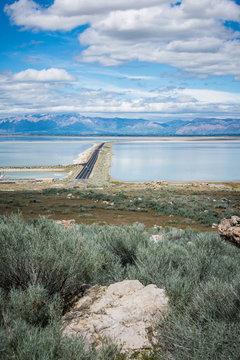 Road leading into Antelope Island State Park in Utah is on a barrier island causeway, crossing the Bridger Bay in Great Salt Lake