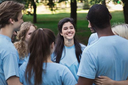 Meeting of young volunteers team in park