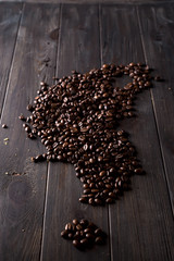 roasted coffee beans, can be used on a wooden dark background