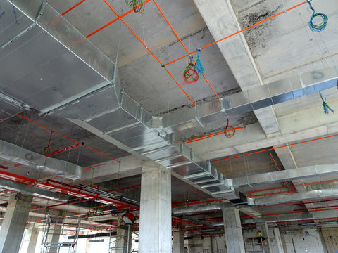 Air-condition and ventilation duct installed by construction workers  at the construction site. Distribute cool air and control the temperature.