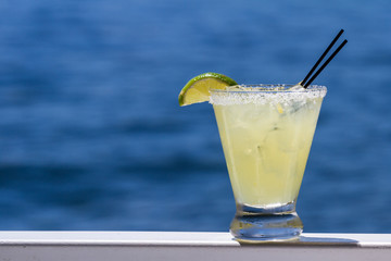 Acrylic Prints Cocktail refreshing margarita on the water