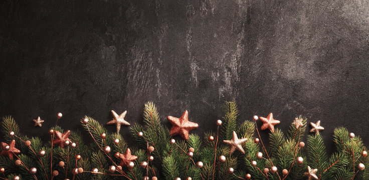 Christmas Decoration With fir Branches on a Dark Shale Backgroun