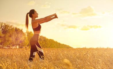 Sporty girl in wheat field