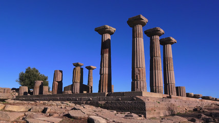 Assos (Behramkale), ruins of ancient acropolis on the blue sky background, Turkey