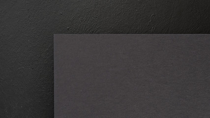 abstract geometric black background. construction paper sheet with empty space for text.