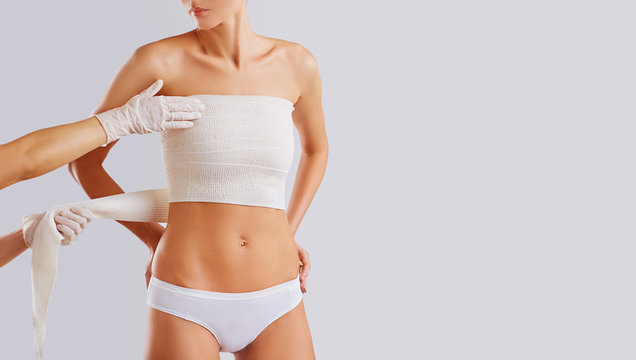 The concept of plastic surgery on the chest of a woman.