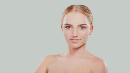 Beautiful face of a young blonde woman. Cosmetology, beauty and spa.