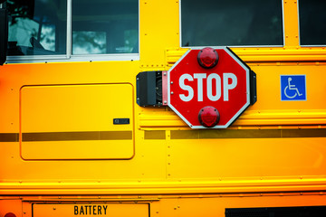 Close up of stop sign on school bus