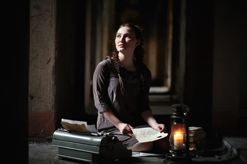 A girl with old books in the old house
