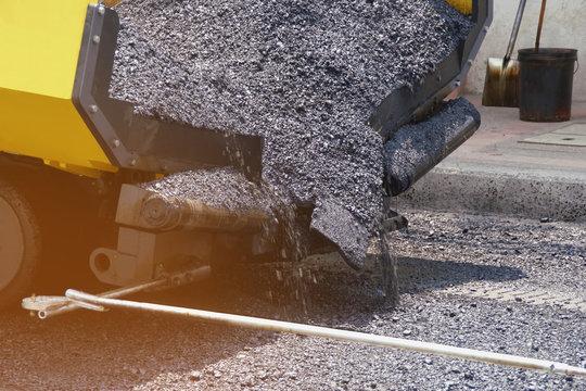 Paving Truck Laying Asphalt, Bitumen at Road Construction