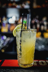 yellow alcoholic drink with lemon on the table