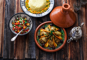 Morrocan cuisine chicken tajine, couscous and salad