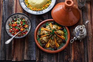 Morrocan cuisine chicken tajine, couscous and salad
