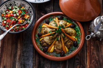 Chicken tajine with couscous, moroccan food, close view.