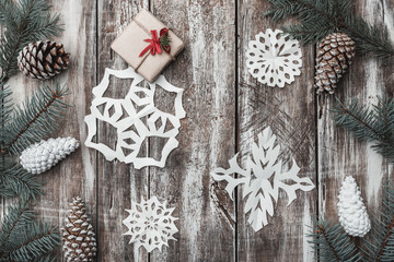 Old wooden. Fir branches, cones. Christmas Fellowship, New Year and Xmas. Space for Santa's message. Gift. Holiday card. Decorative snowflakes. Xmas and Happy New Year composition. Flat lay, top view