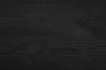 Upper, top view of a black wooden blackboard background in old, rustic style