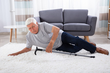 Senior Man Fallen On Carpet