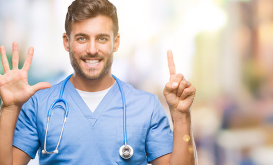 Young handsome doctor surgeon man over isolated background showing and pointing up with fingers number six while smiling confident and happy.