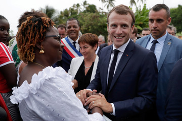 French President Emmanuel Macron is greeted during his visit to Goyave in Guadeloupe
