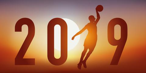 Carte de vœux 2019 sur le thème du basket, avec un basketteur en pleine action, qui tire en extension, pour marquer un panier