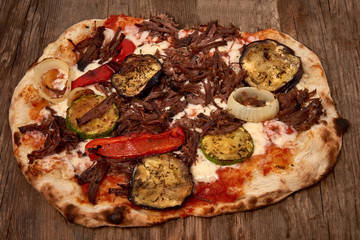 Homemade fresh delicious gourmet pizza,Tasty italian pizza isolated on wooden table, closeup