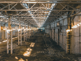 Abandoned and haunted industrial creepy warehouse inside, old ruined grunge factory building