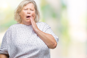 Senior plus size caucasian woman over isolated background touching mouth with hand with painful expression because of toothache or dental illness on teeth. Dentist concept.