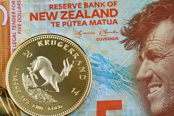 A Macro Image Of Five New Zealand Dollar Bill With Golden Krugerrand One Ounce
